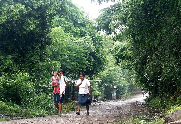 Rural Nicaraguan women walk down a path