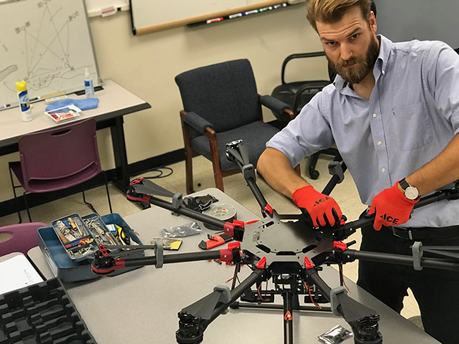 Schoessow works on the RANGER System drone.