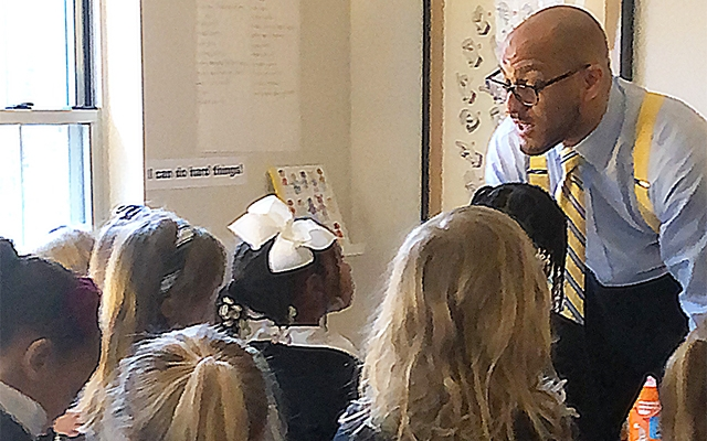 Jeffries presenting to his daughter's class