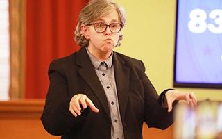Marla Berkowitz interprets for Gov. Mike DeWine during a briefing on the coronavirus.