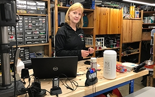 Christy Goodman, an audiology clinical supervisor in the Department of Speech and Hearing Science, stands in her makeshift basement workshop.
