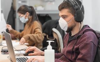 Workers in N-95 masks