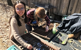 Luna Luo (left) and Molly Rideout (right), students from the 2018 Ohio Field School class, clean and sort type for their service project, which involved assisting with the restoration of Bloody Twin Press.