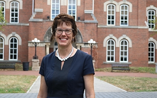 Dean Gretchen Ritter in front of University Hall