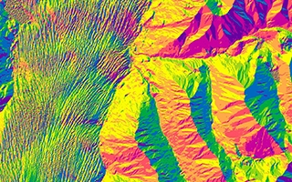 "An ArcticDEM ""aspect"" map, color-coded by the orientation of downward sloping terrain."