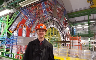 Tony Lefeld, a PhD candidate in the Department of Physics, stands in front of the CMS detector at the Large Hadron Collider at CERN in Geneva, Switzerland.