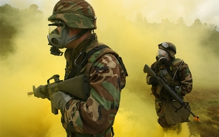 Soldiers training in yellow smoke