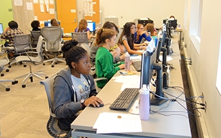 Students at computers learning how to animate