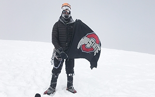 Forrest Schoessow with an Ohio State flag in the Andes Mountains.