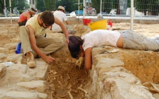 Students participate in an archeological dig.