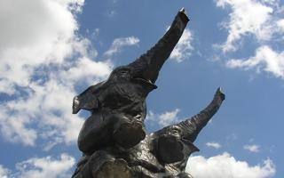 Two bronze elephants.