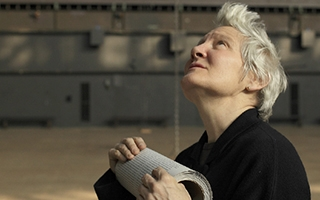 Artist Ann Hamilton working on the installation of the event of a thread (2012-13) at the Park Avenue Armory  in New York. Photo Credit: Thibault Jeanson