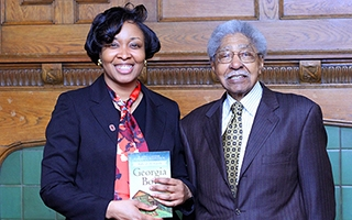 Alumna and author Jessica Johnson with a Columbus legend, Dr. Willburn Weddington.