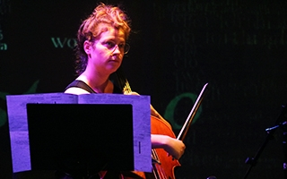 Caitlyn Trevor plays the cello in the ACCAD Motion Lab.