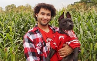 Evan Baugh and his dog, Hades