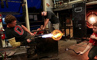 a photo of glass blowing inside Sherman Art Center