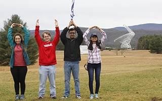 Students pose in O-H-I-O on the site of the Green Bank Telescope in Green Bank, West Virginia.