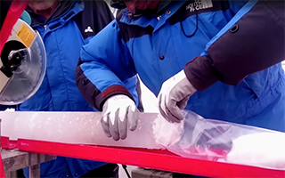 An ice core retrieved from the Guliya Ice Cap in the Kunlun Mountains in Tibet in 2015. Photo by Giuliano Bertagna, courtesy of the Byrd Polar and Climate Research Center.