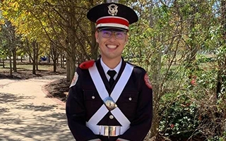 Christopher Lewis in marching band uniform