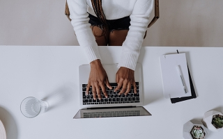 Woman at laptop stock image