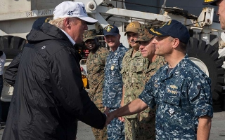 President Donald Trump shakes hands with Capt. David Guluzian of the U.S. Navy