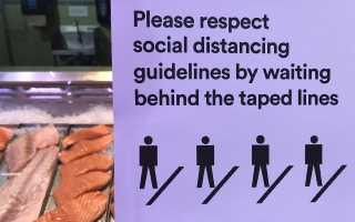 Social distancing sign in grocery store