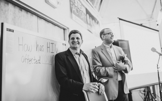 Associate professors Jesse Kwiek (left) of microbiology and Thomas McDow of history at the STEAM Factory for an event that concludes their co-taught course on HIV. Photo courtesy Paul Woo, Wandering Woo Photography