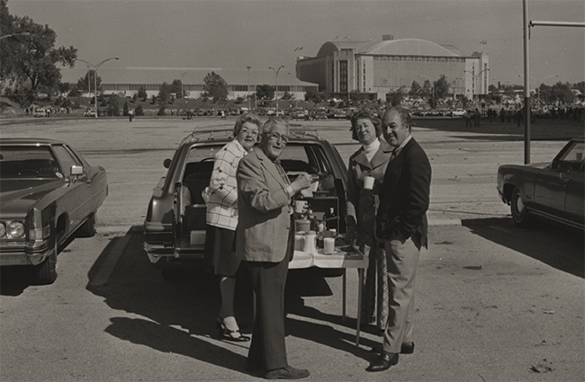 Fans tailgating at a football game in 1968.