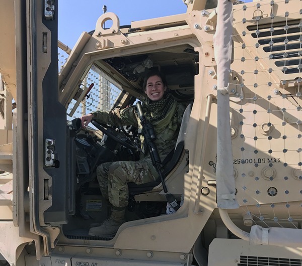 Sarah Wood in a military vehicle
