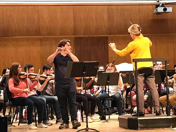 Daniel Zipin playing flute with the Ohio State Symphony Orchestra